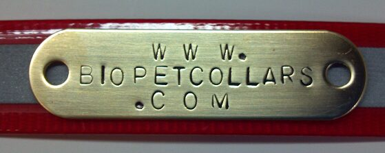 A stamped brass name plate