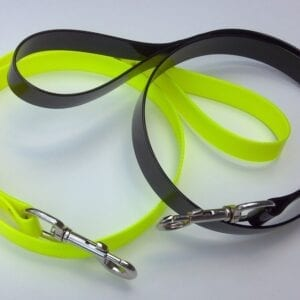 A yellow and a black leash with handles