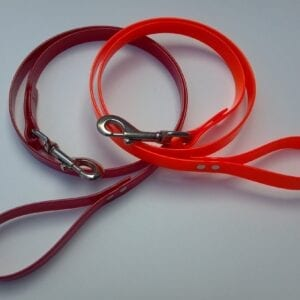 An orange and red leash with handles